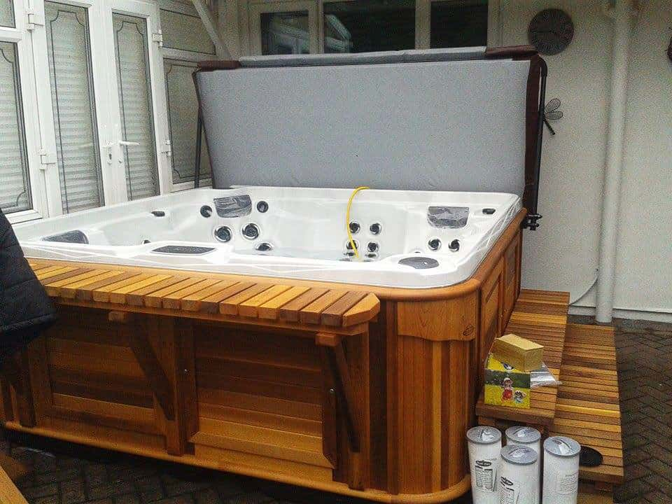 Opened Arctic Spas Hot tub in a room