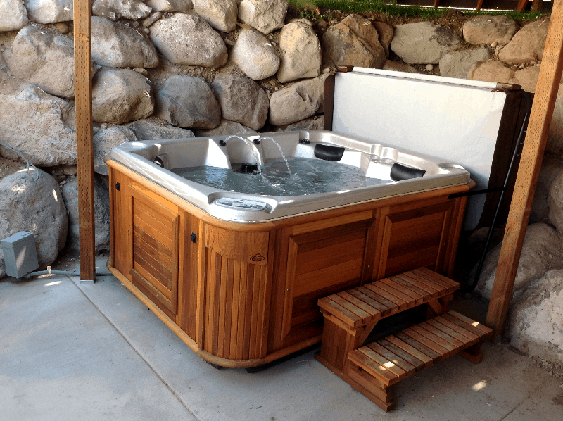 Arctic Spas Hot tub outside in the corner